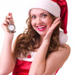 Foto Stock: Woman in Santa Claus clothes with Clock