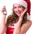 Woman in Santa Claus clothes with Clock — ストック写真