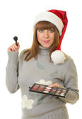 Woman in Santa Claus clothes with beauty cosmetics — Stock Photo