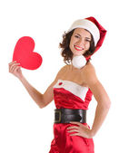 Vacker ung flicka i santa claus kläder med hjärta — Stockfoto