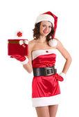 Hermosa joven vestida de santa claus con regalos — Foto de Stock