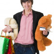 Man with flowers and gifts for valentines day - Stock Photo
