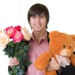 Stock Photo: Young mwith flowers and teddy bear
