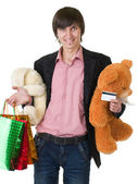 Man with flowers and gifts for valentines day — Stockfoto