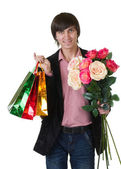 Valentines Man with flowers and shopping bags — Stock Photo