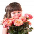 Cute little girl with pink roses on white background — Stock Photo