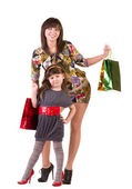 Happy mother and little girl with shopping bags — Stock Photo