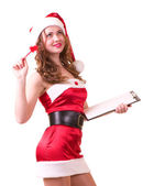 Woman in Santa Claus clothes leaning on blank board — Stock Photo