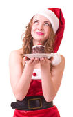 Girl in Santa Claus clothes with tasty cake — Stock Photo
