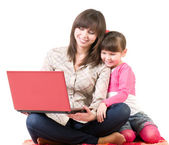 Mother and her little daughter with laptop — Stock Photo