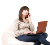Woman with laptop and telephone — Stock Photo