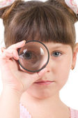 Little girl with magnifying glass isolated on white — Stock Photo