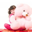Cute little girl with pink bear on white background — Stock Photo