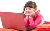 Cute little girl with laptop isolated over white — Stock Photo