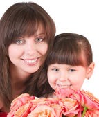 Mother with daughter with pink roses — Stock Photo