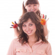 Mother and her little daughter with color paint — Stock Photo #8698175