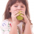 Beautiful little girl with apple — Stock Photo #8698208