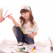 Beautiful little girl with color pencils — Stock Photo