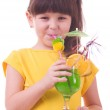 Beautiful little girl drinking green child's cocktail — Stock Photo #8725448
