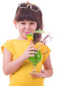 Beautiful little girl drinking green child's cocktail — Stock Photo