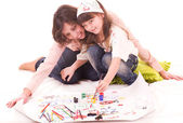 Mother and her little daughter with color paint — Stock Photo