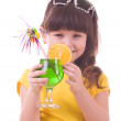 Royalty-Free Stock Photo: Beautiful little girl drinking green child\'s cocktail