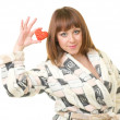 Woman in a plush bathrobe with red heart — ストック写真