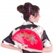 Woman in Asian costume with red Asian fan — Stock Photo #8842104