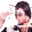Stock Photo: Young beautiful woman with Japanese sushi rolls,