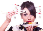 Young beautiful woman with Japanese sushi rolls, — Stock Photo