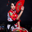 Woman in red Asian costume — Stock Photo #8863077