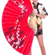 Woman in Asian costume with red Asian fan — Stock Photo #8863098
