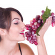 Beautiful young woman with red grape — Stock Photo #8863104