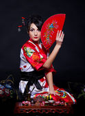 Woman in red Asian costume — Stock Photo