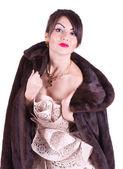 Woman in a fur coat — 图库照片