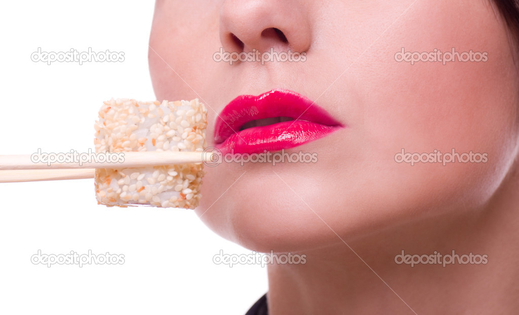 Woman with chopsticks and sushi roll  Stock Photo #8863109