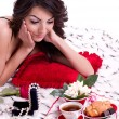 Brunette woman in bed with gifts — Stock Photo #8890837