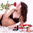 Brunette woman in bed with gifts — Stock Photo #8890839