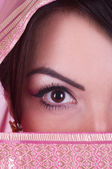 Beautiful womanish eye in pink yashmak — Stock Photo