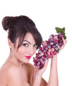 Beautiful young woman with red grape — Stock Photo