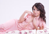 Sexy beautiful brunette girl in pink — Stockfoto