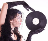 Woman in retro style with vinyl plate — Stock Photo