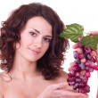 Beautiful young woman with red grape — Stock Photo #8973901