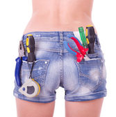 Female worker with tools in back pocket on shorts — Stock Photo
