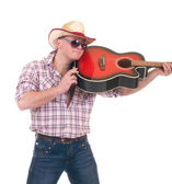 Pretty man with cowboy hat with guitar — Stock Photo