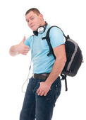 Young student listening to music on headphone — Stock Photo
