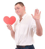 Jonge man bedrijf rood hart — Stockfoto