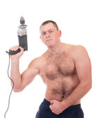 Young man with large drill — Stock Photo