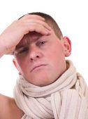 Sick young man having a headache — Stock Photo