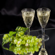 White wine in glass with grape - Stock Photo